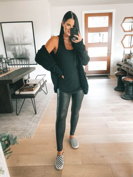 Spanx just launched new faux leather leggings and I'm OBSESSED with these faux leather matte snake leggings! I wear the size small  Use code DTKxSPANX for 10% off your entire order! I linked my layering tank (I wear a large) my vans checkered mules too and I linked some cardigan options!   #LTKstyletip #LTKunder100 #LTKsalealert