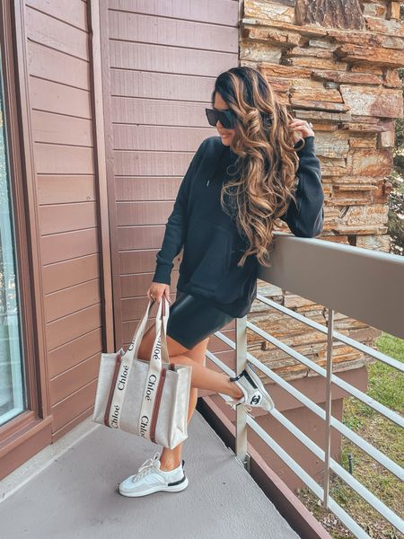 Fall transitional outfit ideas, faux leather biker shorts, black hooded sweatshirt, Chloe tote bag, Chanel sneakers, casual outfit ideas, casual outfit, hiking outfit, oversized sunglasses, Emily Ann Gemma http://liketk.it/3nbrL