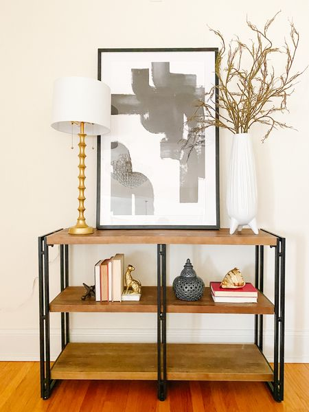 Eclectic mix of an industrial console with modern art and traditional styling.  Console table, black and white art, gold lamp, living room decor, home decor, console style, accent furniture  #LTKhome