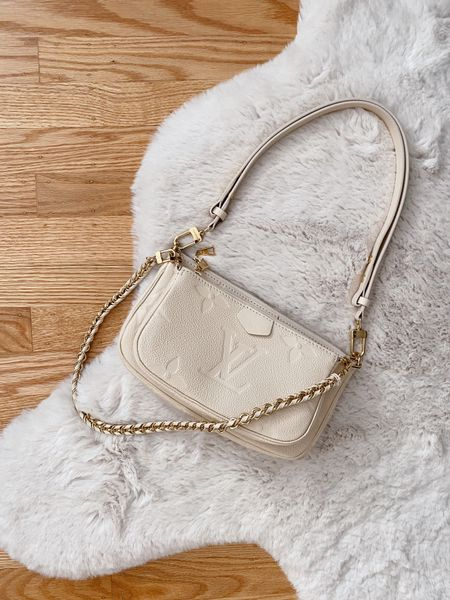A stunning take on the Louis Vuitton multi-pochette accessoires in cream empreinte 😍  #LTKitbag #LTKSeasonal