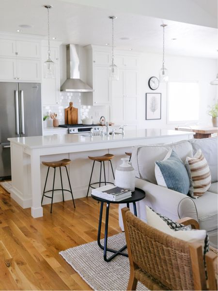 Living room and kitchen decor inspiration. I'm loving this blue striped pillow mixed with the white & wood from the kitchen!     You can instantly shop all of my looks by following me on the LIKEtoKNOW.it shopping app http://liketk.it/3gIH3 #liketkit @liketoknow.it @liketoknow.it.home   #LTKhome #LTKstyletip