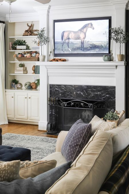 Our living room is ready for a relaxing day of football and being homebodies! Love these fall living room decor ideas!   #LTKhome #LTKSeasonal