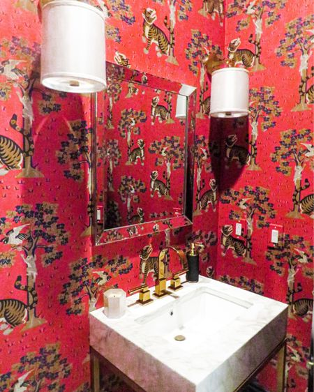Be bold in your Powder Room! This powder room is a favorite due to the amazing red oriental print wallpaper, golden sink handles and the amazing marble sink. It just creates a jewel box feel and amazing style. You will never be able to replicate this look completely but shop the dupes below! You can instantly shop my looks by following me on the LIKEtoKNOW.it shopping app #StayHomeWithLTK #LTKhome @liketoknow.it.home http://liketk.it/34FDF #liketkit @liketoknow.it