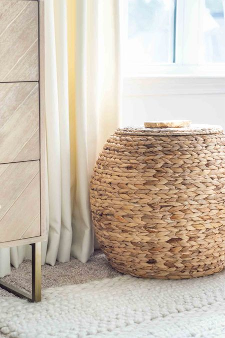 Prep for the holidays with all the baskets! #ad Lidded baskets like this ottoman are perfect for stashing everyday decor when the Christmas decor comes out, or toys in common areas year round! Bonus when a basket can double as a side table, plant stand or stool 👌🏼 Shop some of my favorites from @walmart and #wlamarthome here! Walmart finds home decor storage organization nursery decor accent table #ltkunder50  #LTKhome #LTKHoliday #LTKSeasonal