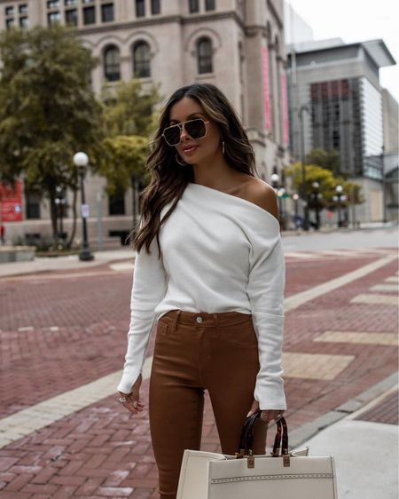 Revolve casual outfit ideas  Camel coated denim wearing a 23 Free People white thermal top Fendi sunshine tote   #LTKunder100 #LTKworkwear #LTKstyletip