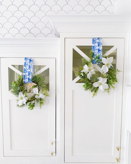 One of my favorite Christmas decorating items to hang up on the kitchen cabinets each year! Mini wreaths with my new blue and white chinoiserie ribbon 💙💫  . .  http://liketk.it/31pYU #liketkit @liketoknow.it #LTKhome #LTKunder50 #LTKsalealert @liketoknow.it.home Christmas wreath, wreaths, holiday decor, kitchen decor, kitchen cabinets, white kitchen, kitchen tile, holiday decorating, mini wreath, blue ribbon, chinoiserie chic, blue and white decor