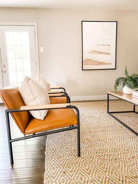 Leather accent chairs in this neutral living room space.  Faux leather chairs, accent chairs, living room decor, neutral art, living room seating  #LTKhome