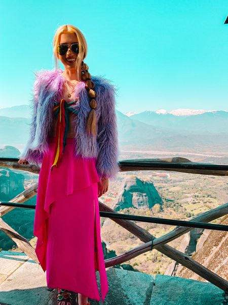 Even when it's warm out you can throw on a shearling furry jacket!  Violet Miss Selfridge Faux Fur Coat  ASOS Design midi skirt with Asymetric hem in pink  Tulum Striped tie Bandeau from Show Me Your Mumu  Star Drop earrings  Ray-band  Jet set candy Athens necklace  The Meteora Monasteries in Greece   #LTKunder100 #LTKtravel #LTKunder50