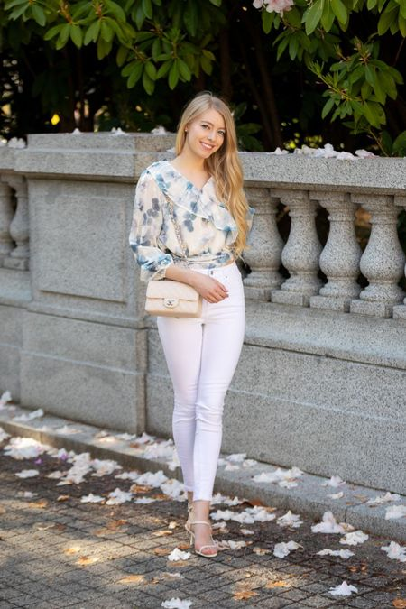 Floral white and blue ruffle top chicwish White skinny jeans high waisted  White bare the row sandals  White Chanel classic mini Spring summer fashion Memorial Day    #LTKstyletip #LTKSeasonal #LTKunder100
