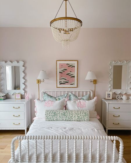 My daughter's pink room with mint & green accents was one of my favorite spaces to design! The details like the wavy mirrors, scalloped bedding and beaded chandelier add just the right amount of whimsy to the space. What I love most about this room is that it will grow with her - a classic Jenny Lind bed is always in style and I used a timeless textile for the bolster pillow. Follow me in the LIKEtoKNOW.it app @veronabrit to shop this room! #LTKkids #LTKhome http://liketk.it/3fjy3 #liketkit @liketoknow.it @liketoknow.it.home