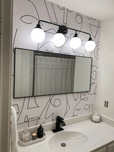 Guest bath energy ⚡️ Wanted something funky to take away from the 90's shell sink! Fun wallpaper, statement light, new faucet, and black decor! Linking our marble cabinet pulls too. Wallpaper is from @wall.blush  #LTKunder100 #LTKhome