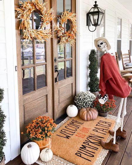 Halloween and fall decor. Porch front doors spiral topiary tree skeleton layered doormat wreath pumpkins   #LTKunder50 #LTKSeasonal #LTKhome