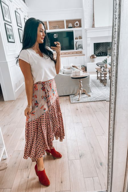 Similar tiered skirts linked  Red bootie options  Beaded red earrings  Lace v neck blouse comes in tank and shirt- many colors.   http://liketk.it/3foFl #liketkit @liketoknow.it Sunday best  #anthro Amazon finds  Amazon fashion #LTKstyletip #LTKsalealert Download the LIKEtoKNOW.it shopping app to shop this pic via screenshot