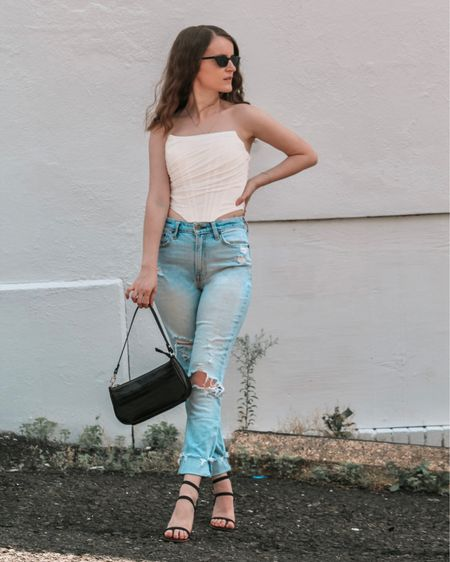 a corset top paired with high rise mom jeans , strappy sandals , shoulder bag, and sunnies makes a trendy summer outfit. Shop my daily looks by following me on the LIKEtoKNOW.it shopping app  http://liketk.it/3j3dM #liketkit @liketoknow.it l #LTKcurves #LTKsalealert #LTKstyletip #LTKtravel #LTKunder50 #LTKshoecrush #LTKitbag #LTKunder100 # #LTKSeasonal  Nordstrom   summer fashion   summer outfits women   Abercrombie   abercrombie jeans   amazon fashion   amazon finds   Abercrombie & Fitch   summer tops   high waisted jeans   mom jeans   ripped jeans   straight leg jeans   light wash jeans   petite style   petite fashion   bags on sale    bags under 50   bags under 100   sandals casual