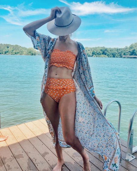 Best sellers from June: this floral duster kimono and high-waisted bikini 👙 Both pieces are under $25 and perfect for summer vacation ☀️ The swimsuit fits TTS, has removable straps, and comes in several prints http://liketk.it/2D3W8 @liketoknow.it #liketkit #LTKstyletip #LTKswim #LTKtravel #LTKunder50 #ltksummer, cover-up, orange, boho, sun hat, smocking, ruffles