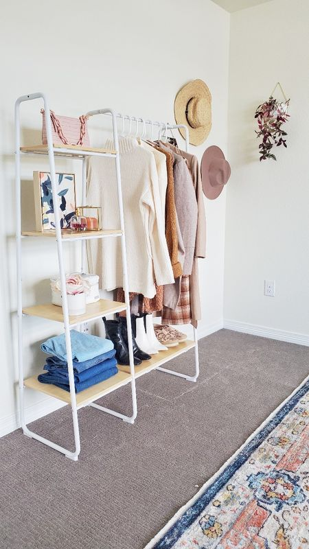 Turning my Cloth rack into more Summer-ish. I recently started working on my home workspace and loved this clothing rack from Amazon only for $90. I love that it has wood slabs which gives it a very pretty look. #ltkhome #ltkseasonal #ltkdecor #homedecor   #summerwardrobe #summerdecor #competition #amazonfinds