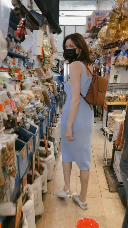 Baby blue Slit-front ribbed dress, white sneakers and a brown backpack.   Follow me on the LIKEtoKNOW.it shopping app to get the product details for this look and others    #LTKunder50 #LTKSeasonal #LTKstyletip