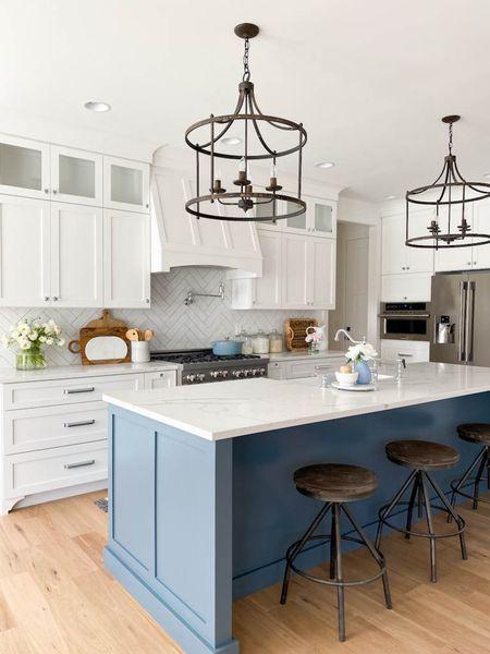 White kitchen with a blue island. Kitchen Lighting, bar stools, faucets, pot filler.   http://liketk.it/3ciky #liketkit @liketoknow.it #LTKsalealert #LTKhome  Shop my daily looks by following me on the LIKEtoKNOW.it shopping app