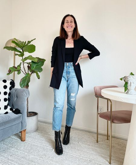 Styling straight leg Levi's 501 jeans with ankle Chelsea tall boots from @mgemi and a bodysuit and blazer   #LTKSeasonal #LTKstyletip