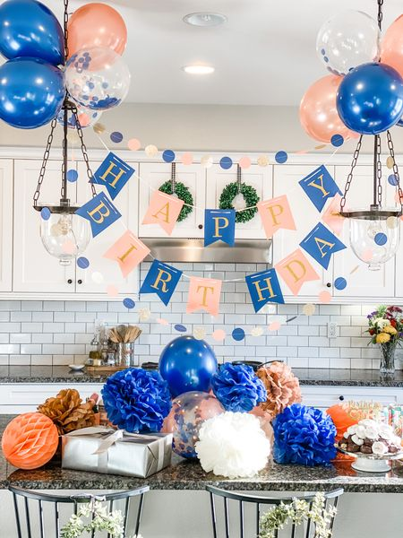 Navy blue, gold, champagne and peach birthday decorations.  Balloons. Garland. Tissue paper flowers.     #LTKfamily #LTKhome #liketkit @liketoknow.it @liketoknow.it.family http://liketk.it/3bOhQ @liketoknow.it.home