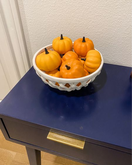 Fall home decor / entryway decorations / navy blue entry table / small orange pumpkins / white woven bowl    #LTKHoliday #LTKhome #LTKunder50