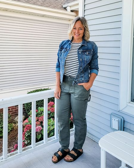 Casual everyday fall teacher mom weekend outfit featuring olive utility cargo joggers, a striped tee, denim jacket, and Birkenstocks #Petite #teacher #mom #joggers #utility #cargo #olive #striped #Birkenstocks #denimjacket #truckerjacket #midsize #fall #lifestyle http://liketk.it/3lPtY @liketoknow.it #liketkit