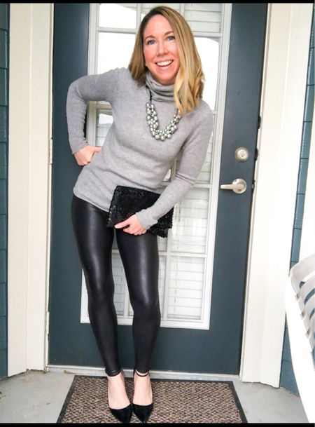 """A dressy way to wear your spanx faux leather leggings.  Would be perfect for a holiday outfit or night out.    I paired mine with a cashmere turtleneck sweater, statement necklace and heels.  This is a comfortable  & cozy, yet stylish way to wear these leggings throughout the Fall and Winter weather.   Recommend going up a size in the leggings if in between.  I wear them in small petite.  ( I'm 5'3"""")   Spanx leggings also make a great holiday gift for her!   I've had mine for years and love them.          Leggings outfit , faux leather leggings , spanx leggings , holiday style , holiday outfit , casual dressy , cashmere sweater ,  spanx , amazon fashion , #ltkshoecrush , #ltkholidaystyle , Thanksgiving outfit , Christmas outfit , family photo outfit , #ltkworkwear #ltkgiftguide   #LTKSeasonal #LTKunder100 #LTKHoliday"""