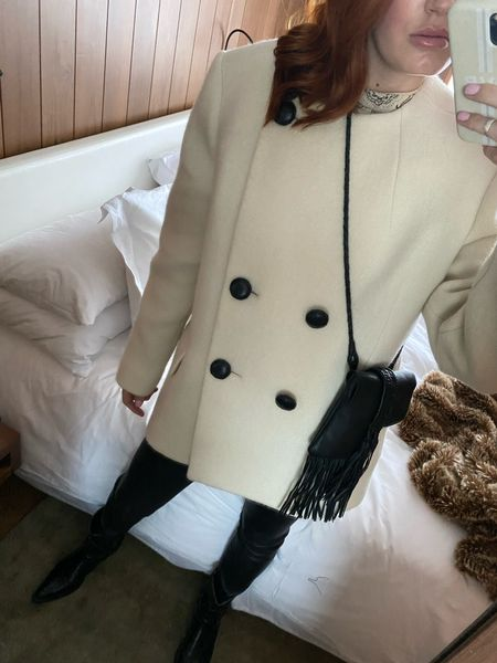 I have gotten so many compliments on my Isabel Marant coat. It is VERY warm and has picks in the front.  It was chilly in London so I wore it with leather pants and cowboy boots but it also works as a mini dress (with a dress or skirt underneath).  My bag is old Mango.   #LTKworkwear #LTKtravel #LTKeurope