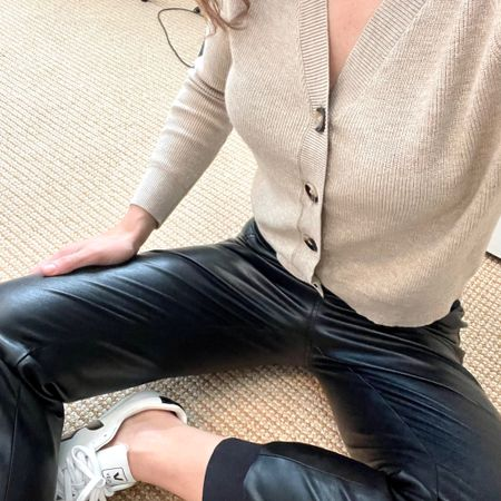 Cardigans and easy-to-wear pants are a go-to of mine in the fall! Check out this cute, effortless outfit I styled together. Perfect for running errands, a casual dinner with a friend and more! | #knittedcardigan #fallcardigans #fallcardigan #croppedcardigan #fauxleather #fauxleatherpants #leatherpants #leatherbottoms #vejasneakers #JaimieTucker   #LTKstyletip #LTKSeasonal