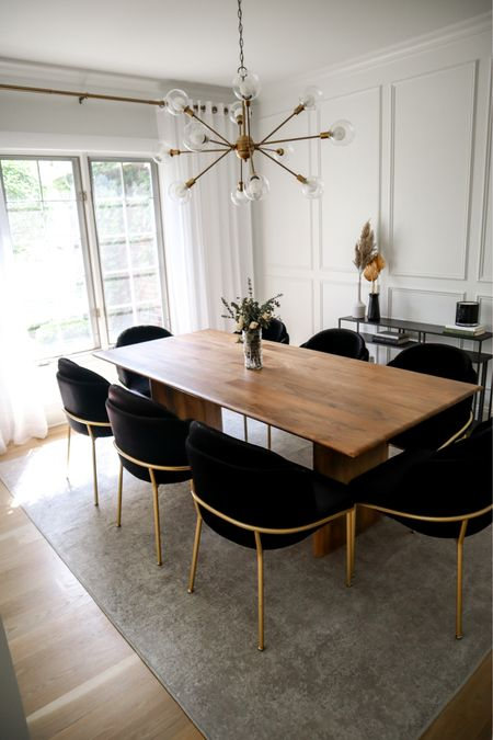 Dining room brown wood table black velvet chairs. Table is 86inches