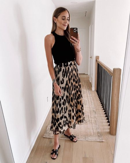 Love this leopard skirt for summer (tts). Paired with a black tank and black sandals #leopard #summeroutfit #sandals http://liketk.it/3ihgH #liketkit @liketoknow.it #LTKstyletip #LTKsalealert #LTKunder100