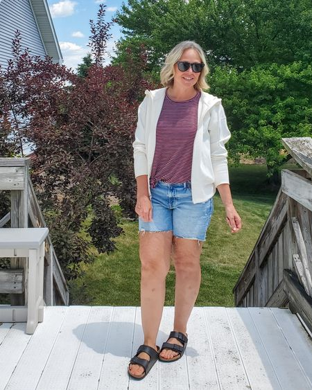 Casual everyday summer mom outfit featuring a loose striped ribbed muscle tank, denim shorts, a white cream hoodie jacket, and Birkenstocks #summer #mom #casual #comfortable #hoodie #redwhiteandblue #holiday #weekend #everyday #denimshorts #tanktop #petite #midsize #modest #teacher http://liketk.it/3hKIy @liketoknow.it #liketkit