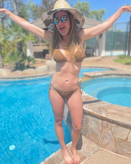 Living in this target leopard bikini. Separates makes sense for us ladies who are not one size fits all. I am hard on swimsuits with constant trips into the pool, beach and lake so don't like spending a ton on swimwear. http://liketk.it/3dc6l #liketkit @liketoknow.it #LTKunder50 #LTKswim #LTKstyletip #targetswim #bikini #momswimwear