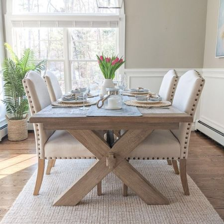 Our dining room table is one of my favorite furniture purchases of all time, even five years later!  @liketoknow.it @liketoknow.it.home #liketkit #LTKhome #LTKunder100 http://liketk.it/3jsAR #LTKfamily  summer decor, summer home decor, summer home, coastal decor, beach house decor, beach decor, beach style, coastal home, coastal home decor, coastal modern, coastal interiors, coastal decorating, coastal house decor, coastal farmhouse decor, neutral home decor, tablescapes summer, tablescapes spring, tablescapes for spring, tablescape blue, tablescape ideas, tablescapes neutral, coastal table decor, coastal dining room, tablescape farmhouse, coastal farmhouse decor, coastal table setting, coastal tables, chargers, jute chargers, chargers plates, easter tablescape, spring tablescape, summer tablescape, napkin rings, white dinnerware, white dinnerware set, white dinner plates, blue and white home, blue and white tablescape, blue and white table runner, neutral table runner, water hyacinth placemats, Target home, Target finds, target style, pottery barn rug, pottery barn chunky wool jute rug, pottery barn dining room, pottery barn dining table, pottery barn dining room table, light wood dining table, dining table farmhouse, dining table farmhouse modern, dining table coastal, farmhouse dining table, dining table with leaf dining room lights, dining room lighting, upholstered dining chairs, dining chairs upholstered, dining chairs, dining room decor, textured rug, textured runner, 5x8 rugs, 6x9 rugs, 8x10 rugs, 9x12 rugs, 10x14 rugs, pendant lights, pendant lights for kitchen, pendant lights kitchen, pendant lights dining, pendant lights dining room, pendant lights polished nickel, pendant light, large pendant lights, kitchen island pendants, kitchen island pendant lights, 6 light pendant, coastal abstract art