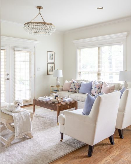 Living room decor, neutral home decor, blue pillow cover, pillow covered, ottoman, accent chairs, sofa, white lamp, round chandelier, neutral rug. http://liketk.it/3h8Lg @liketoknow.it.home #liketkit @liketoknow.it