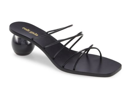 #nsale Cult Gaia slide sandals with a mid heel are still in stock in the Nordstrom Anniversary sale but there's only 1 or 2 left in some sizes so grab them now before they sell out & the sale ends 8/8. These super cute strappy black Cult Gaia sandals are under $300 in the sale ($428 after sale). The sales open to everyone now so snap these modern beauties up. Grab these N sale shoes now before the N sale 2021 ends 8/8 glamourandgains.com  #liketkit @liketoknow.it #nordstrom #cultgaia #cultgaiasandals   #LTKsalealert #LTKshoecrush