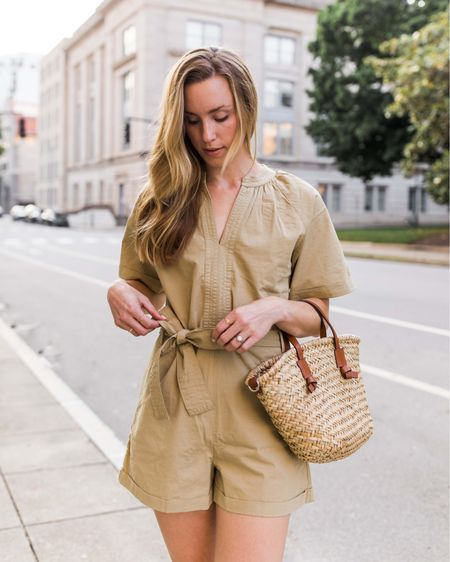 """I feel like I've shared this Mango utility romper about 600 times by now, but I just love one and done outfits for summer—this checks all the boxes (and it's under $100!)! Linking more summer rompers and jumpsuits I love in the """"similar"""" section of this post. I took a small in this one!   Summer outfits, summer outfits casual, casual summer outfits, mango outfits, cellajaneblog, utility romper, neutral summer outfit, summer outfits weekend, summer outfits easy, cute summer outfits, cella Jane, woven tote, woven bag small, leather and straw bag, tie waist romper    #LTKSeasonal #LTKstyletip #LTKunder100"""