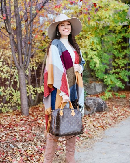 This $21 Amazon poncho is the only thing that kept me warm over the weekend. It's like one big cozy blanket and I love the fall colors! It would be perfect for family photos.  I'll link some similar brown boots here!   Click the link in my bio to shop this look OR shop in the LTK app!  Tags: fall family photos, felt hat, tall suede boots, fall outfits   #LTKunder50 #LTKHoliday #LTKSeasonal