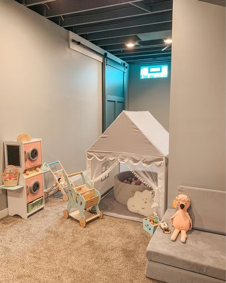 """A play zone for a princess 🧸🎀 All basement playroom and toy details linked on my @shop.ltk page Shop this pic via screenshot or search """"sarahguiler"""" in the app! @liketoknow.it http://liketk.it/3jb5W #liketkit #LTKhome  #LTKfamily #playroom #basement #nuggetcomfort #playhouse #kidsroomdecor #pretendplay #kidsplayroom #ballpit #barndoor #playroomdecor #toddlertoys #kidkraft #cuddleandkind #creativeplay #playspace #decorforkids - - - - - - #playroomideas #ltkkids #playroominspo #mommyblogger #toddlerroom #LTKkids #playroomdesign #playtime #basementceiling #modernfarmhouse #playspace #hellotravelblog"""