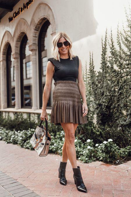 Black shoulder pad tee with a faux leather skirt and my favorite fall handbag 🖤✔️  #LTKstyletip #LTKunder100 #LTKSeasonal