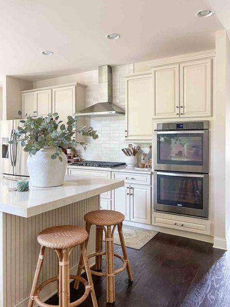 My kitchen is fall ready! Home decor kitchen decor counter stool faux eucalyptus kitchen runner white vase kitchen island styling  #LTKhome #LTKSeasonal #LTKstyletip