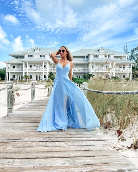 I got this floaty blue maxi dress to go with my surroundings on vacation. It moves beautifully in the breeze and has a sexy thigh high of and criss cross back. It'd be great for a wedding guest or bridesmaid dress too and runs true to size.   #LTKstyletip #LTKtravel #LTKwedding