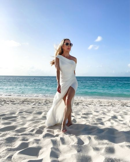 Wander endlessly, live deeply, this is your journey 🤍  📍 @sevenstarsresort 👗 @macduggal . . .  #gracebaybeach #tci #providenciales #turksandcaicos #luxurytravelblogger #macduggal #nsale #luxurytravel #instatravelgram #sevenstars #sevenstarsresort #destinationwedding  #LTKwedding