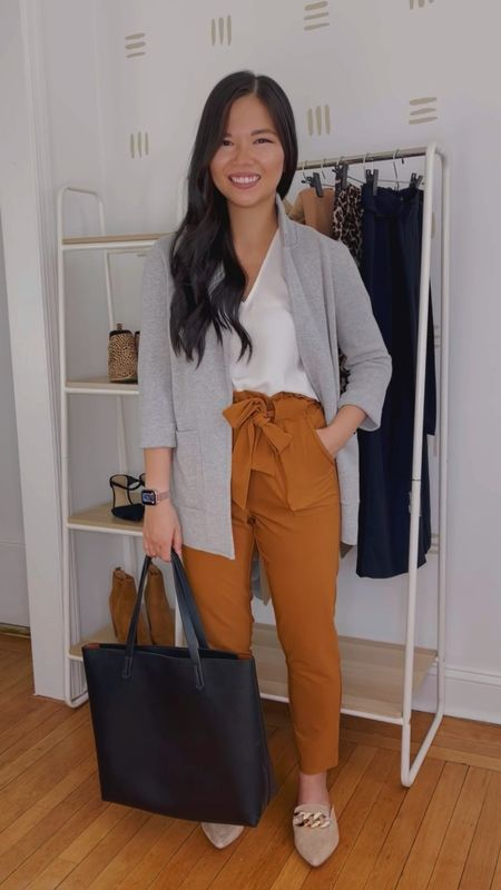 Five fall outfit ideas for the business casual office!  Monday: Gray sweater blazer (sized down to an XXS), cream v-neck tank (XS), mustard pants (XS), black tote bag, tan suede mules (TTS).  Tuesday: Dusty pink sleeveless too (XS), gray plaid ankle pants (4P), black suede pumps (TTS).  Wednesday: Black v-neck tank (XS), black wide leg pants (small petite), brown work tote bag, leopard flats (linked similar).  Thursday: Brown cardigan (XS), leopard blouse (XS), khaki wide leg pants (M), brown ankle strap heels.  Friday: pink sleeves too (XS), high waisted skinny jeans (28S), beige quilted purse, nude mules (linked similar).  Amazon fashion, Amazon finds, Ann Taylor, J.Crew, work outfits, teacher outfits, fall style, workwear, business casual outfits.  #LTKstyletip #LTKunder50 #LTKworkwear