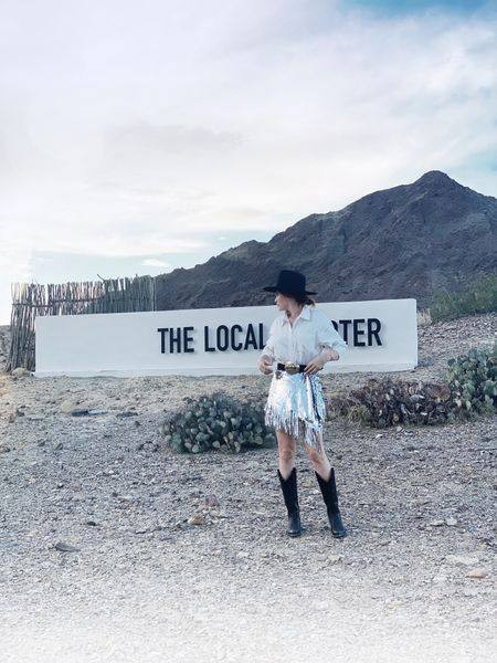 Spent the weekend at The Local Chapter at the Big Bend National Park.  My skirt runs VERY small- order up at least one size. The sequin fringe can be dressed up or down. My boots are by a local Texas woman, a military veteran.   #LTKworkwear #LTKwedding #LTKtravel