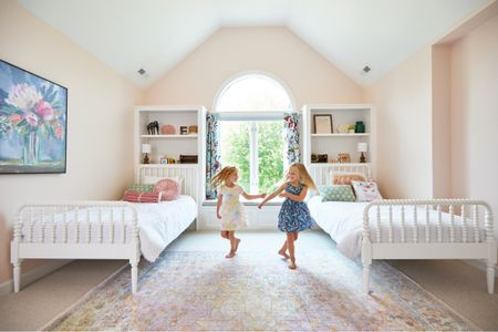 """""""I don't have a stepsister. I just happen to have a sister that is not related by blood."""" A labor of love (and patience!) and it's finally done! Elliott and Eloise's shared bedroom is finally on the blog. Details and sources linked!   #kids #kidsbedroom #bedroom #bedroomdecor #littlegirl #pink #pinkandblue #stepsisters #sisters #blendedfamily #family #sharedbedroom #jennylind #twinbeds   #LTKfamily #LTKkids #LTKhome"""