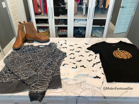 Cute Halloween sweatshirt and Halloween fall T-shirt for trick-or-treating or going to the pumpkin patch. The T-shirt with the leopard pumpkin runs really small so size up a few sizes. I got the extra large and normally wear a small. I got the sweatshirts in size medium. Boots run true to size.   Fall outfit, brown boots, black boots, target boots, fall fashion, women's fashion, bat sweatshirt, spiderweb sweatshirt, leopard pumpkin T-shirt. Modern farmhouse glam  #LTKSeasonal #LTKhome #LTKHoliday