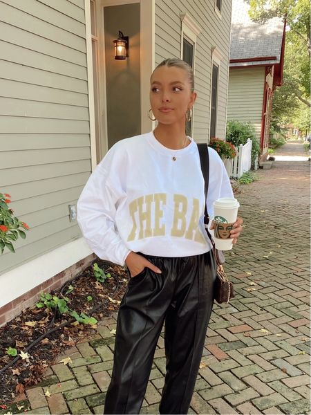 weekend casual outfit style, faux leather joggers from amaryllis size medium, The Bar sweatshirt (not linkable) size L, revolve hoops + gold rings, and natural makeup from Ulta, bronze and glowy, Gloss + face beauty makeup linked   #LTKSeasonal #LTKstyletip #LTKunder50