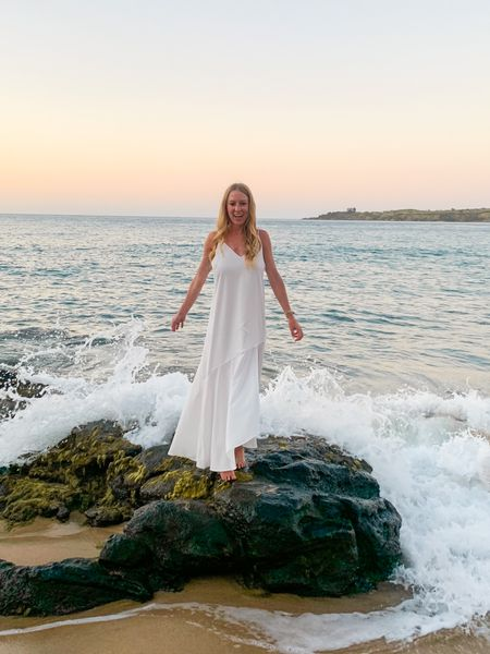 Long white flowy maxi dress with a slit for sunset honeymoon pictures on the beach. I got mine in a boutique in Hawaii and tagged a few similar styles to recreate this look!  #LTKunder50 #LTKtravel #LTKwedding
