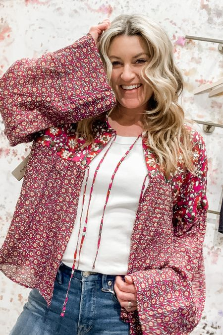 Peasant top/jacket from Free People has the cutest sparkle detail with bell sleeves. Easy tie front is so simple but really cute. With jeans or over a dress this is colorful and fun. http://liketk.it/3988L #liketkit @liketoknow.it Follow me on the LIKEtoKNOW.it shopping app to get the product details for this look and others